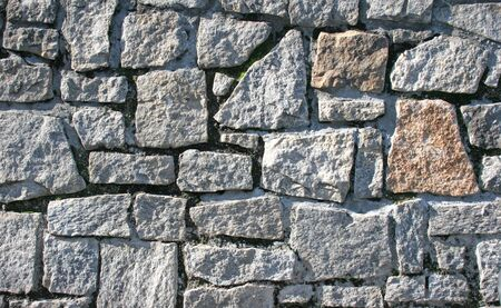 wall textures: Colorful and textured stone masonry wall useful for backgrounds Stock Photo