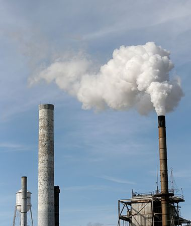 Smokestacks spewing steam into the blue sky Stock Photo - 717313