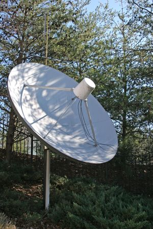A Large dirty satellite dish in trees Stock Photo - 734061