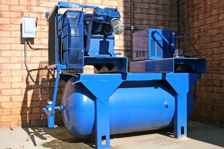 compressor: Bright blue air compressor on commercial building