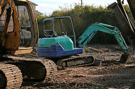 front end: Blue Front End Loader on a muddy job site