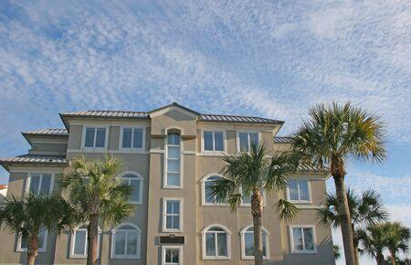 Nice beachfront stucco coastal condo building against sky Stock Photo - 756202