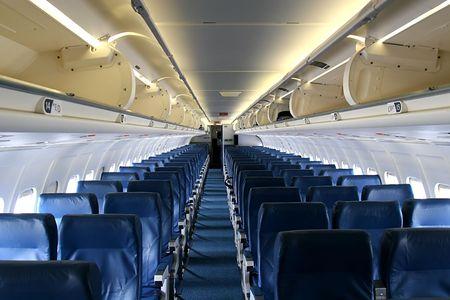 Shot down center aisle of an empty passenger jet Stock Photo