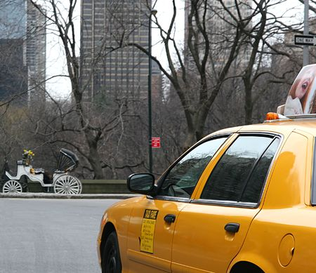 taxicab: A yellow cab on 57th street in New York City