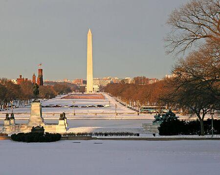 The Washington mall in snow with Washington monument photo