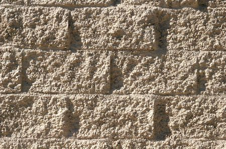 Wall made of concrete blocks and stucco for background or details photo