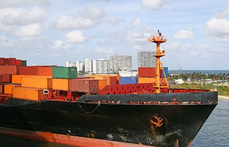 Freight on a ship entering a harbor Stock Photo