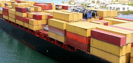 An ocean going freighter loaded with many cargo boxes