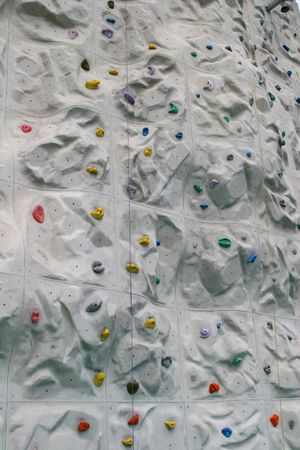 Colorful closeup of a rock climbing wall