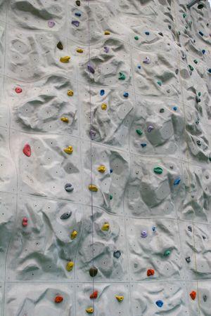 climbing  wall: Colorful closeup of a rock climbing wall