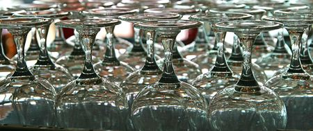 glasswear: Glassware displayed in a rack in a bar
