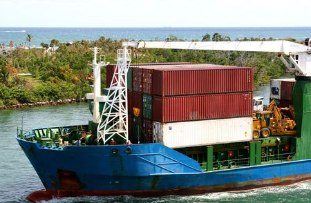 Ocean going freight loaded onto a barge Stock Photo