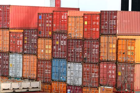 Stack of colorful freight containers on a dock