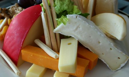selections: A tray of cheese selections on a buffet