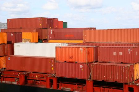 Different colored freight containers on a shipping dock