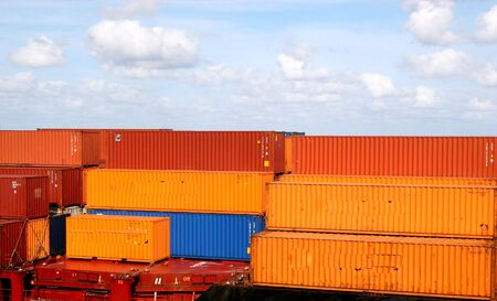 Orange and blue freight containers in a harbor Stock Photo