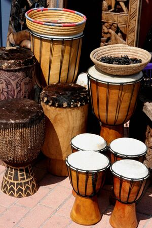 A selection of hand crafted drums at a flea market