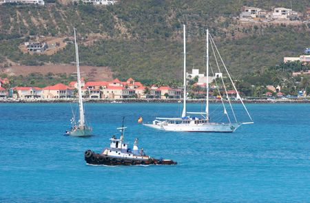 Sailboats and a tug boat in a bay Stock Photo - 832178