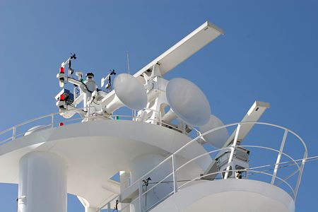 sonar: Top of a cruise ship showing satellite and sonar receiver