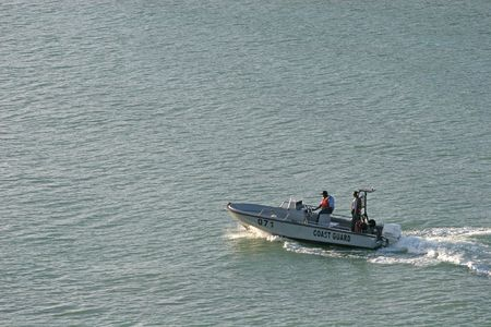 A Coast Guard motor boat speeding across the bay Stock Photo - 850131