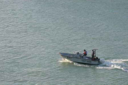 A Coast Guard motor boat speeding across the bay Stock Photo - 850131