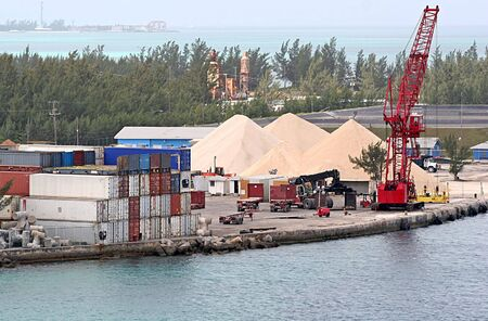 Shipping area on a bay with freight containers and sand Stock Photo
