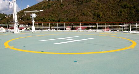 helicopter pad: Landing pad for a helicopter on the bow of a ship