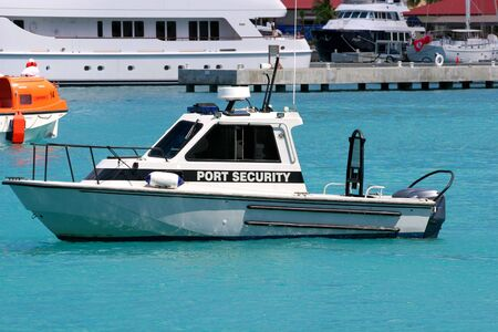 Port security motor boat speeding across the bay Stock Photo - 858141