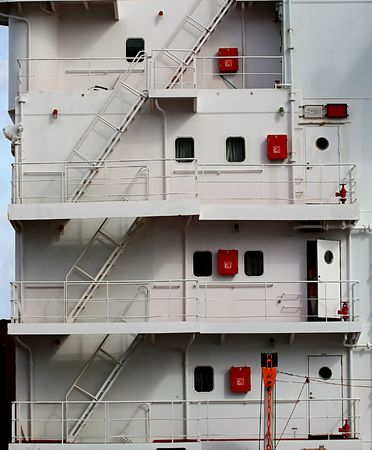 Metal stairs running up the decks of a ship