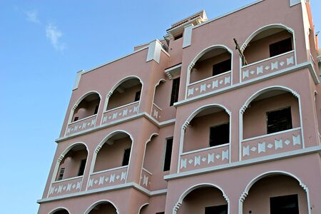 Pink stucco apartment building in tropical area Stock Photo - 876056