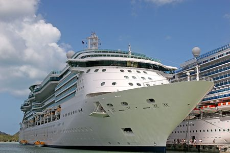 Two Cruise ships docked alongside each other in port Stock Photo