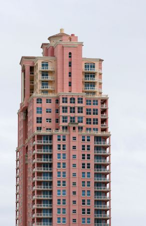 A pink high rise condo complex on the beach Stock Photo - 881125