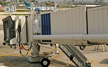 embark: A jetway for a commercial airliner at an airport