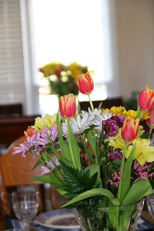 Two bouquets of Easter flowers on dining tables photo