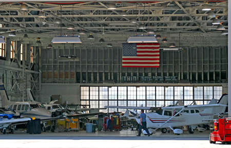 Working aircraft hanger in a busy small airport