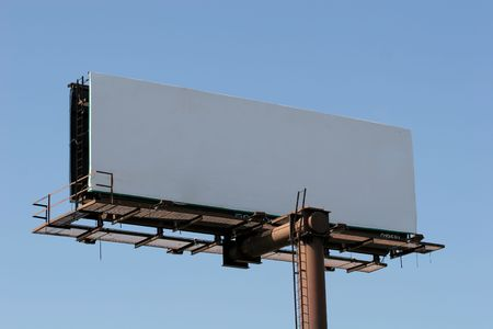 A blank billboard against blue sky useful for advertising