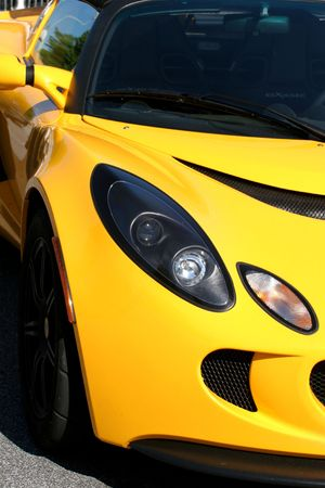 Closeup of a bright yellow sports car