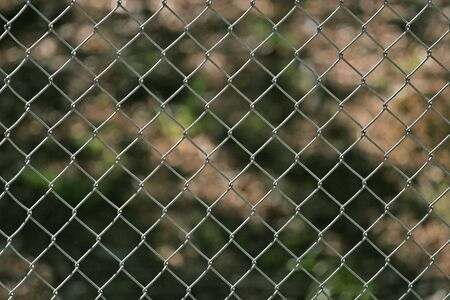 A steel chain link fence for use as a background Stock Photo - 894718