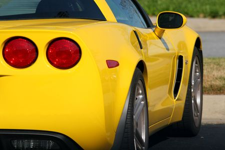 Rear view of a bright yellow sports car