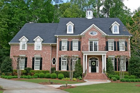 realty residence: A nice brick two story home with landscaping Stock Photo