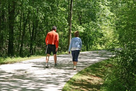 An older couple for a walk along an urban fitness trail