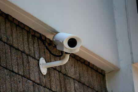 close circuit camera: A close circuit security camera looking at the photographer Stock Photo