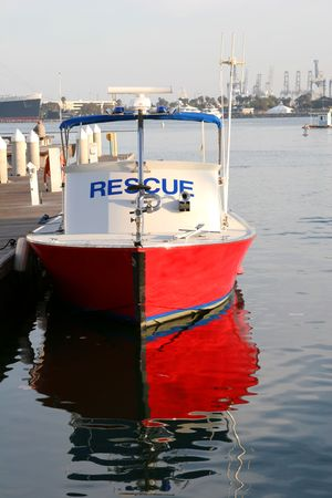 A red rescue boat with reflection in water Stock Photo - 950392