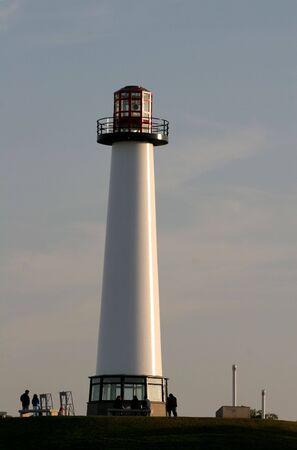 White lighthouse in golden light of dusk Stock Photo - 964494
