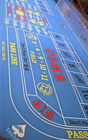 A blue craps table in a casino