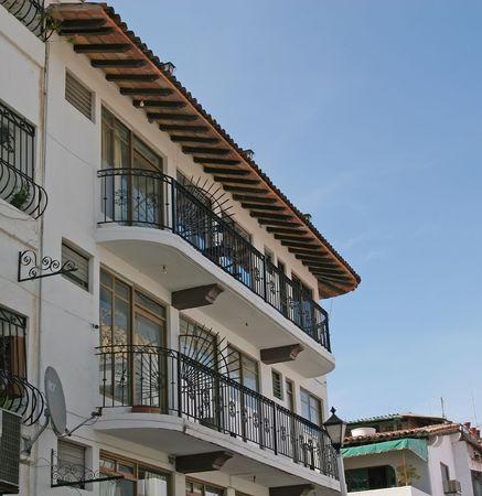 verandas: Tropical coastal condos with classic iron railing verandas