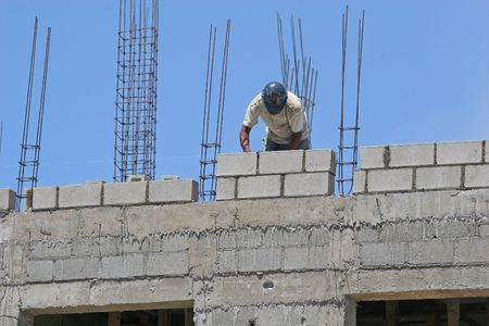 Construction worker on a concrete block wall project