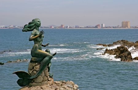 Old mermaid statues of the coast of Mexico