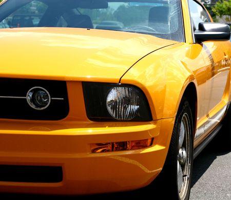 A closeup of a bright orange sports car photo