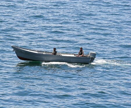 A Port security boat with military personnel Stock Photo - 1126503